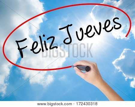 Woman Hand Writing Feliz Jueves (happy Thursday In Spanish) With Black Marker On Visual Screen.