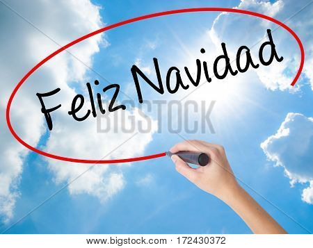 Woman Hand Writing Feliz Navidad  (merry Christmas In Spanish) With Black Marker On Visual Screen