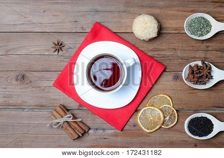 A Cup Of Hot Tea And Spices On A Wooden Table.