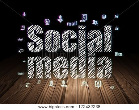 Social network concept: Glowing text Social Media,  Hand Drawn Social Network Icons in grunge dark room with Wooden Floor, black background