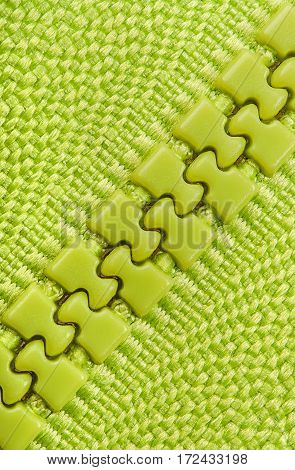 Abstract background green closed zipper diagonally located