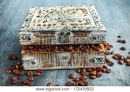 Coffe beans in old wooden white chest.