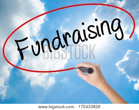 Woman Hand Writing Fundraising With Black Marker On Visual Screen