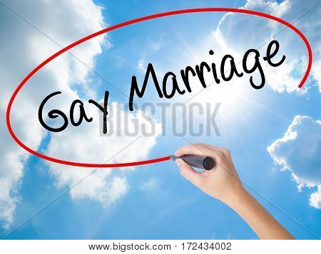 Woman Hand Writing Gay Marriage With Black Marker On Visual Screen.