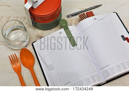 Planning the day - checking diary notes and having lunch at same time