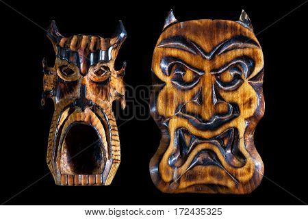 wooden devils mask isolated on black background