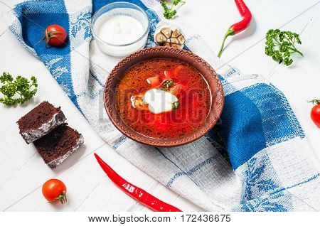 Traditional Ukrainian Russian vegetable borscht soup on light background.