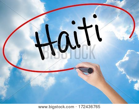 Woman Hand Writing Haiti With Black Marker On Visual Screen