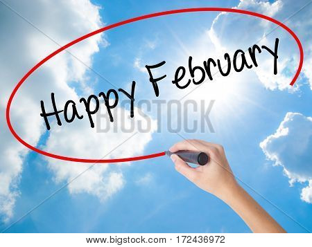 Woman Hand Writing Happy February With Black Marker On Visual Screen