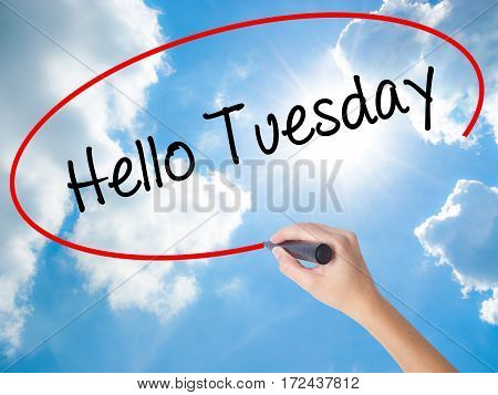 Woman Hand Writing Hello Tuesday With Black Marker On Visual Screen
