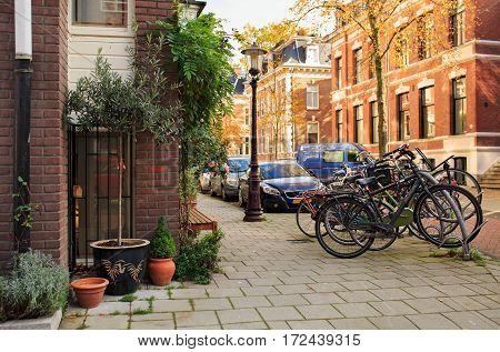 AMSTERDAM/ THE NETHERLANDS - OCTOBER 25, 2015. Quiet residential street Vondelstraat near the city park Vondelpark. Amsterdam, The Netherlands..