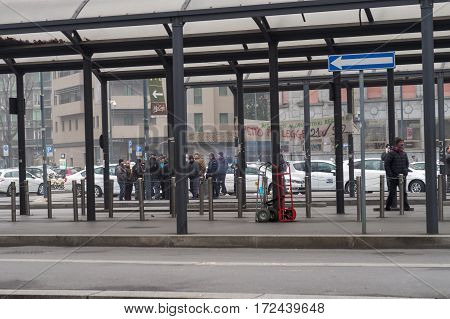 Milan, Italy - February 20 2917: Italian taxi drivers on strike. Taxi drivers continue their strike gathered at taxi stand on Milano Central Train station area under police presence.