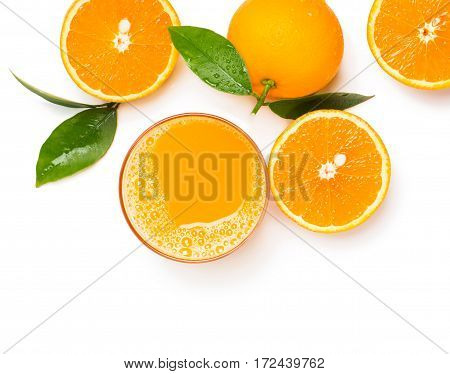 Top view of orange juice in glass and orange fruits with green leaves isolated on white background.
