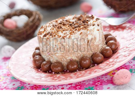 Chocolate curd paskha with chocolate candy on holiday Easter table