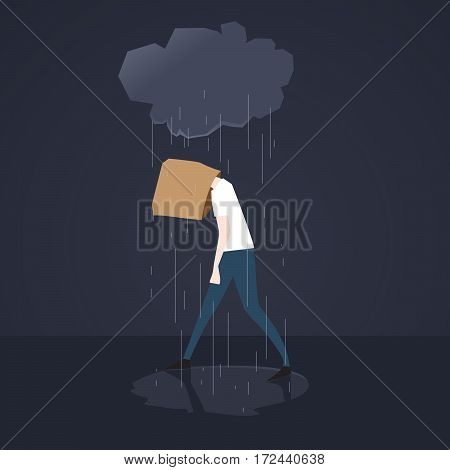 Depressed man walks in the rain with paper bag on his head