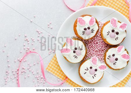 Easter bunny cupcakes on plate top view