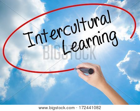 Woman Hand Writing Intercultural Learning With Black Marker On Visual Screen