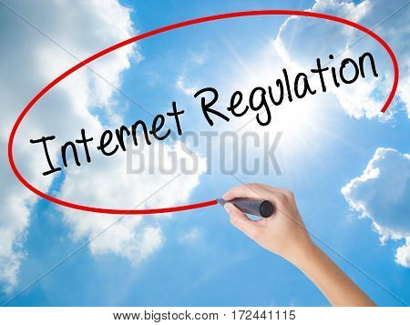 Woman Hand Writing Internet Regulation With Black Marker On Visual Screen
