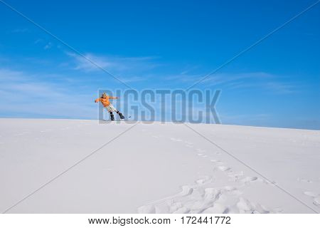 Man Does A Trick On The Snowboard In The Desert