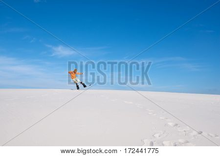 Guy In The Bright Shirt Does A Trick On The Snowboard In The Desert