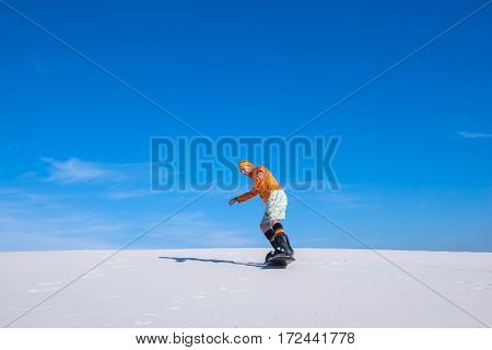 Snowboarder Drives Off Down The Sand Dune
