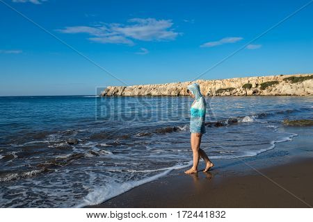 Beautiful Woman Goes Along The Surf Line