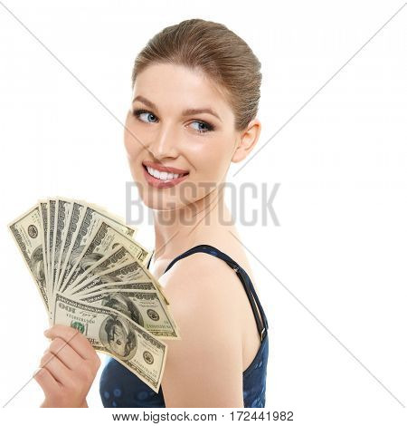 Young happy woman holding cash money dollars happy smiling and looking at copyspace in top left corner of picture, isolated on white background.