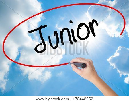 Woman Hand Writing Junior With Black Marker On Visual Screen