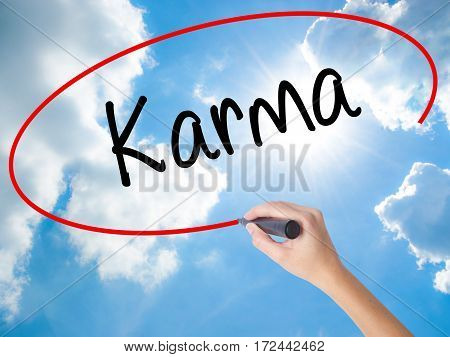 Woman Hand Writing Karma  With Black Marker On Visual Screen