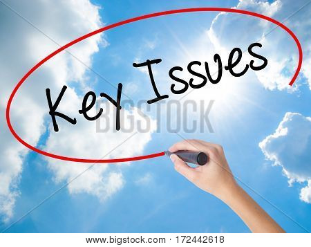 Woman Hand Writing Key Issues With Black Marker On Visual Screen