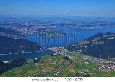 Lake Vierwaldstattersee Lucerne and green meadows. View from mount Stanserhorn.