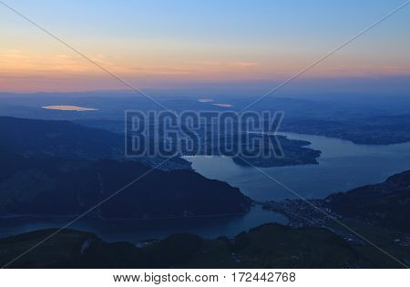 View from mount Stanserhorn. Lake Vierwaldstattersee and Lucerne just before sunrise.