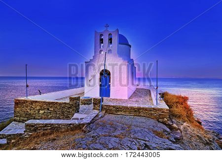 night church of Seven Martyrs at night Sifnos Cyclades Greece - Aegean sea background
