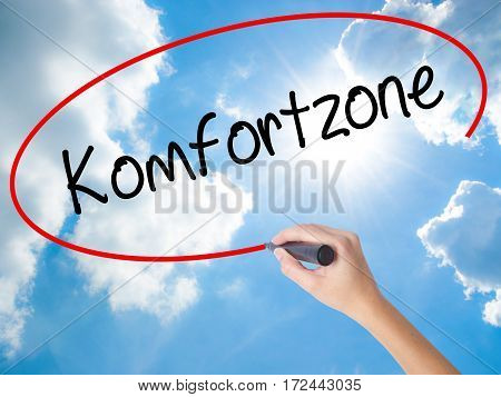 Woman Hand Writing Komfortzone  (comfort Zone In German)  With Black Marker On Visual Screen