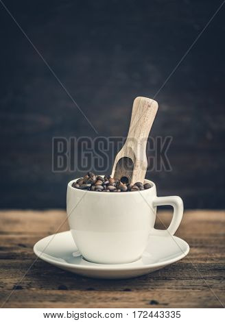 White Ceramic Cup Full of Roasted Coffee Beans