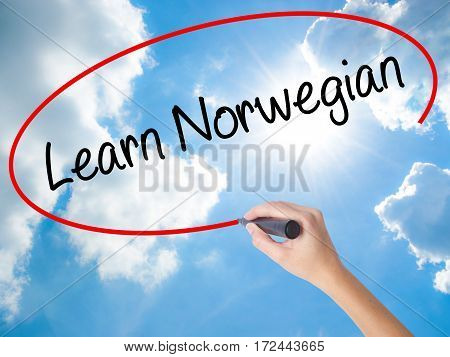 Woman Hand Writing Learn Norwegian With Black Marker On Visual Screen.