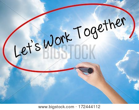 Woman Hand Writing Lets Work Together With Black Marker On Visual Screen