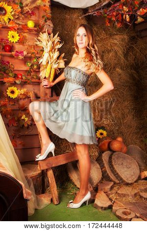 Beautiful blonde on hay barn