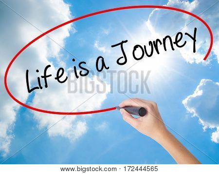Woman Hand Writing Life Is A Journey With Black Marker On Visual Screen.