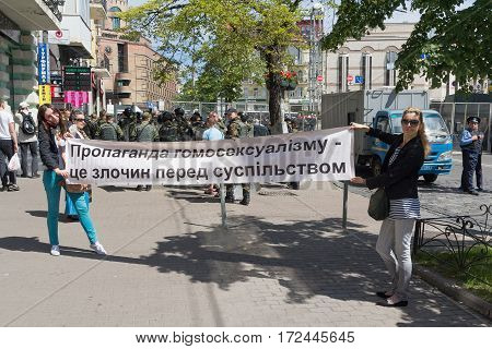 Kiev Ukraine - June 12 2016: Opponents of the parade of sexual Minority with a poster -