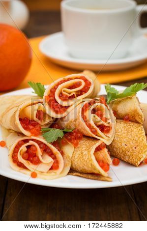Rolls Pancakes With Red Caviar. Russian Cuisine. Flat Lay. Maslenitsa. Wooden Background. Top View.