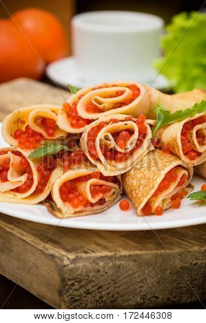 Rolls Pancakes With Red Caviar. Russian Cuisine. Flat Lay. Maslenitsa. Wooden Background. Close-up