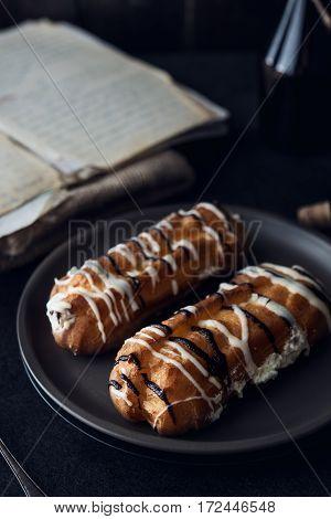 Sweet Eclair Dessert On Black Background