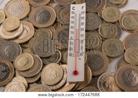 Thermometer instrument and metal Turkish Lira coins