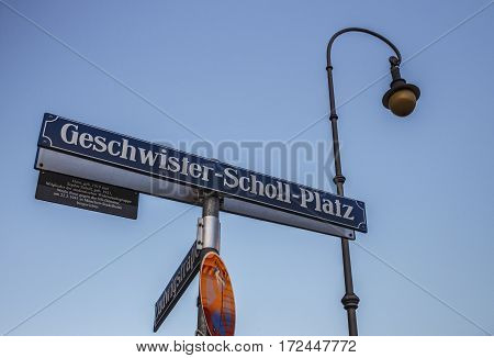 Street sign of the Geschwister-Scholl-Platz (Siblings Scholl Plaza) in front of the main building of the Ludwig Maximilian University of Munich the name honors the founding members of the White Rose resistance movement