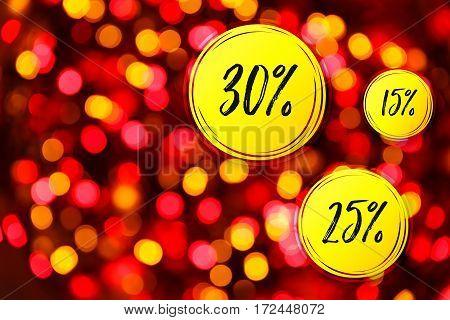 Blurred lights red background. Sale discounts circles. Glittering christmas effect. Shimmering blur spots. Festive design.