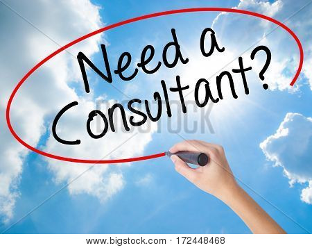 Woman Hand Writing Need A Consultant? With Black Marker On Visual Screen
