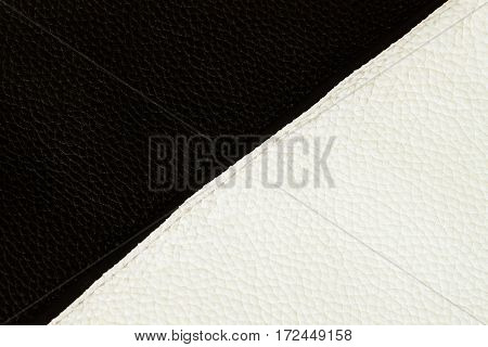 Texture of black and white genuine leather close-up sewn with stitch. For background , backdrop, substrate, composition use. Place for your text