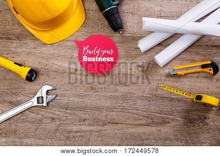Helmet, screwdriver and flashlight. Build your business speech bubble. Construction design. Tape measure. Adjustable wrench, architecture plans and knife.