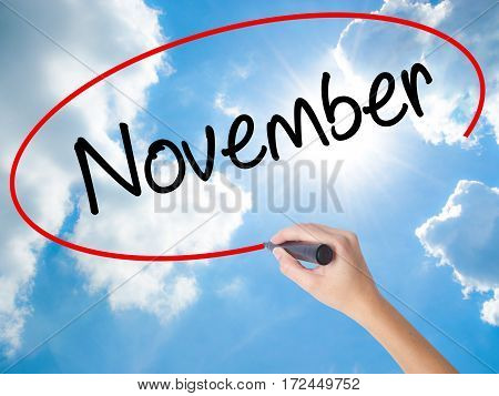 Woman Hand Writing November With Black Marker On Visual Screen
